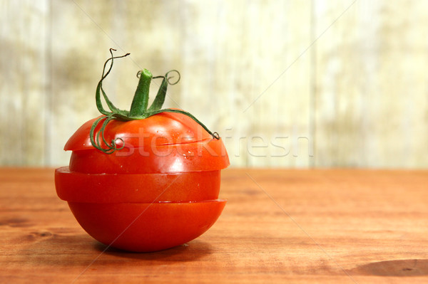 Tomatoes on a Rustic Wood Plank Stock photo © tobkatrina