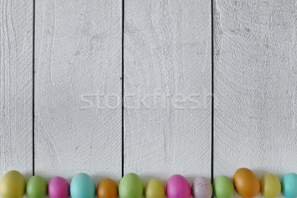 Stock photo: Easter or Spring Themed Background of Old Wood and Colored Eggs