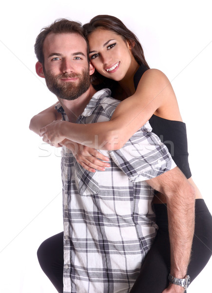Happy Couple Piggybacking his Beautiful Girlfriend Stock photo © tobkatrina