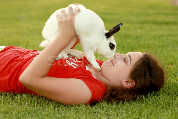 Child and Her Pet Bunny Playing Outdoors Stock photo © tobkatrina