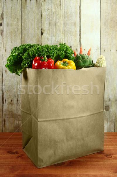 Bag of Grocery Produce Items on a Wooden Plank Stock photo © tobkatrina