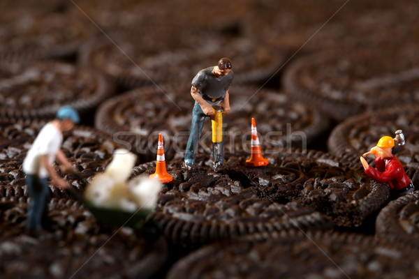 Construction Workers in Conceptual Imagery With Cookies Stock photo © tobkatrina