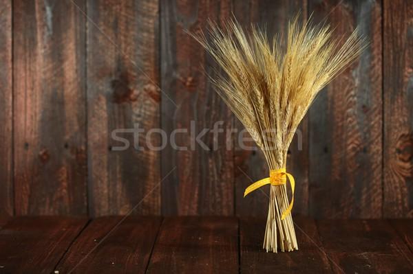 Wheat Grain Stalks on Grunge Wooden Background Stock photo © tobkatrina