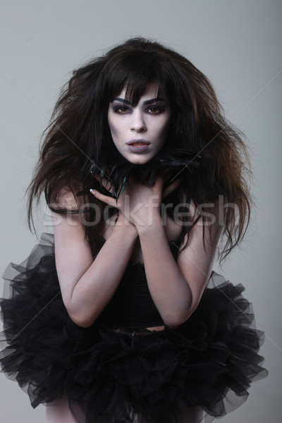 Gothic Expressive Girl on Plain Background Stock photo © tobkatrina
