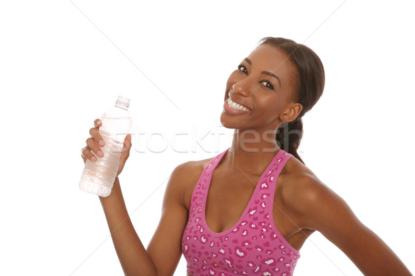 Happy Young Woman Working Out and Doing Fitness Activities Stock photo © tobkatrina