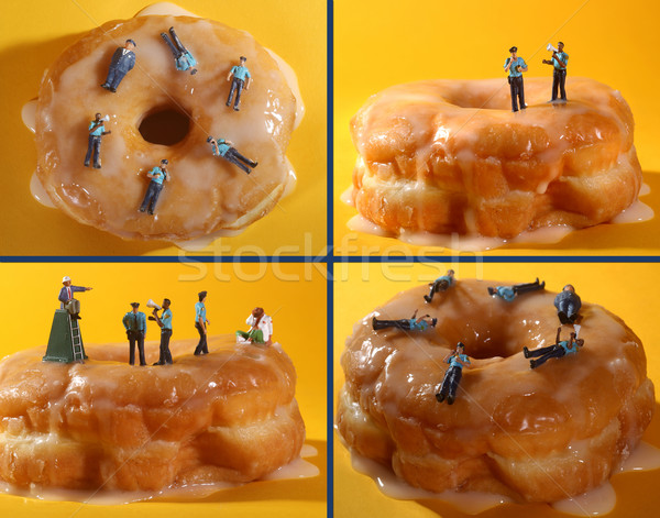 Police Officers in Conceptual Food Imagery With Doughnuts Stock photo © tobkatrina