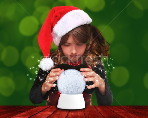 Stock photo: Holiday Girl Looking Into a Christmas Snow Globe