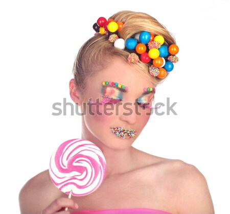 Woman With Candy Lolliops and Surprised Expression Stock photo © tobkatrina