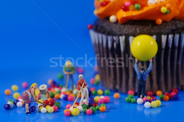 Plastic People Cleaning Up a Messy Cupcake Stock photo © tobkatrina