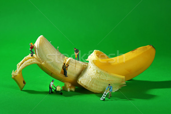 Construction Workers in Conceptual Food Imagery With Banana Stock photo © tobkatrina