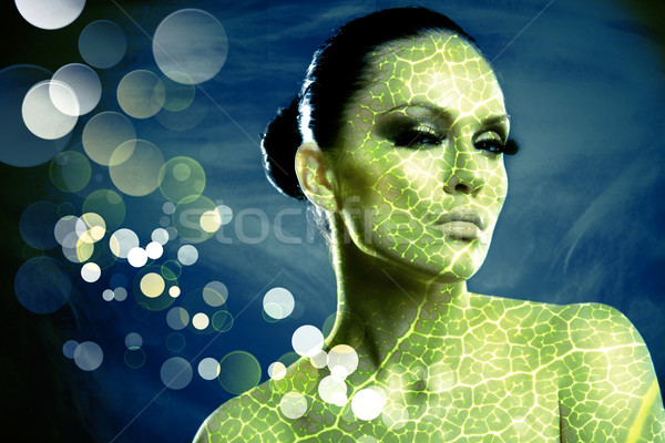 Young beauty woman stylish portrait. Leaf texture added Stock photo © tolokonov
