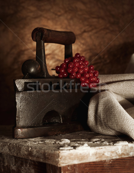 Retro still life with old rusty iron and textile Stock photo © tolokonov