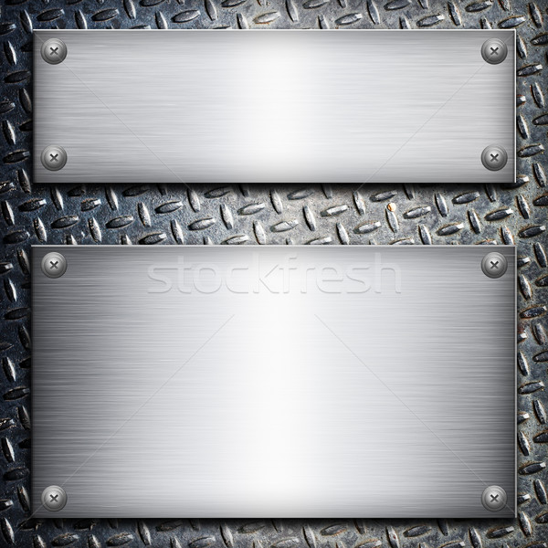 Brushed steel plate over black metall background for your design Stock photo © tolokonov