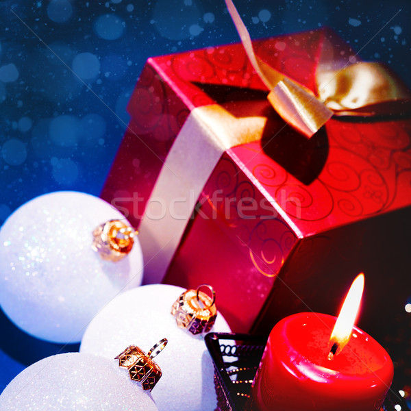 Christmas background with candle and decorations on blue Stock photo © tolokonov