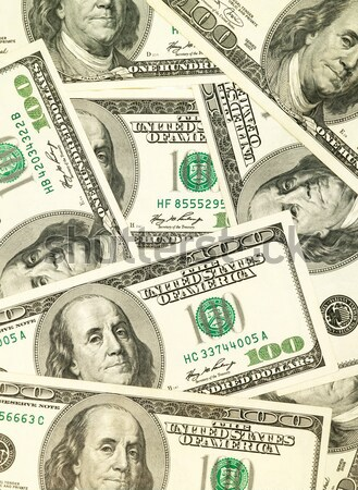 Money background from hundred bucks banknotes Stock photo © tolokonov