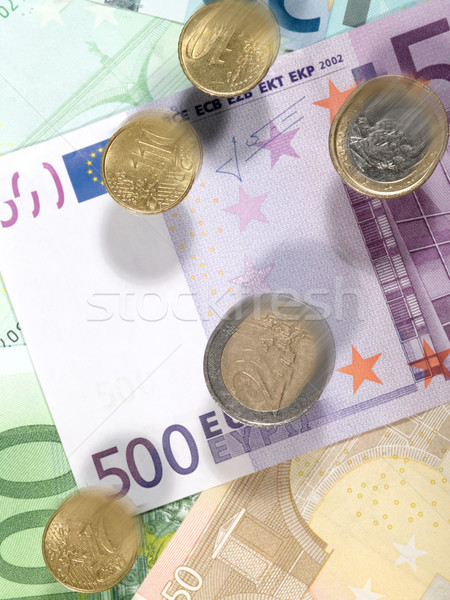Flying coins.Money background from euro banknotes and coins Stock photo © tolokonov