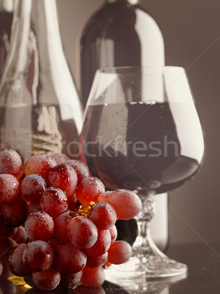 Old wine. Still life with wine bottles and goblet Stock photo © tolokonov