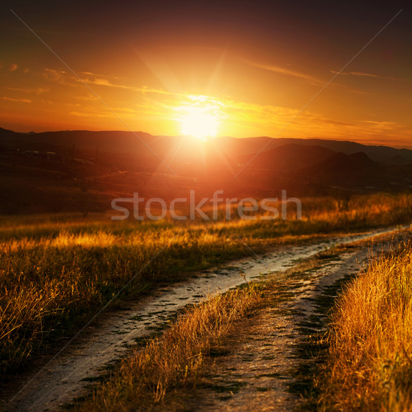 Dramatic sunset over autumnal valley, natural landscape Stock photo © tolokonov