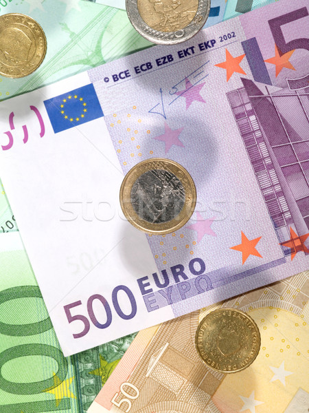 Money background from euro banknotes and coins Stock photo © tolokonov