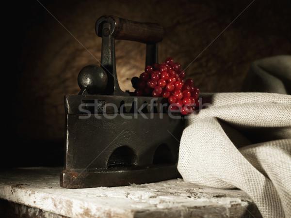 Retro still life with old rusty iron and textile Stock photo © tolokonov