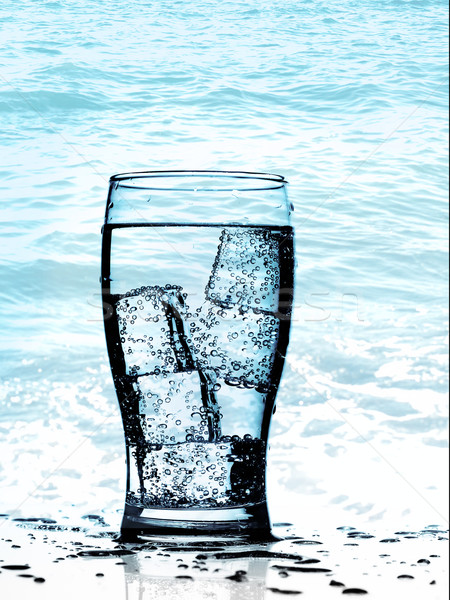 Cold purified water in the glass with bubbles and reflection on  Stock photo © tolokonov