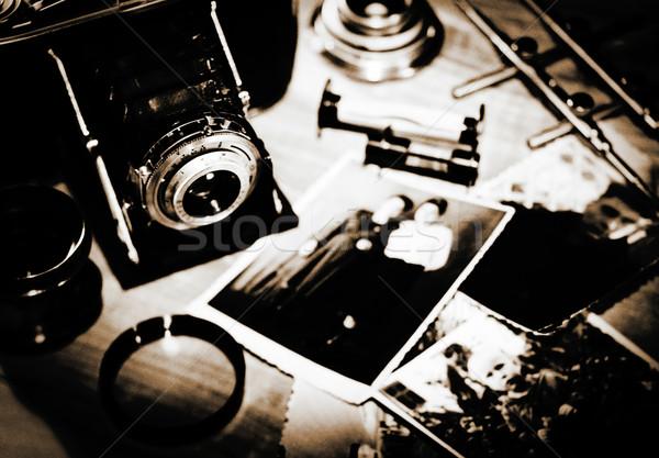 Vintage still life with retro photo camera and old photos Stock photo © tolokonov