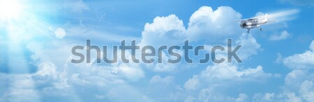 Blue skies with bright sun and airplane as abstract backgrounds Stock photo © tolokonov