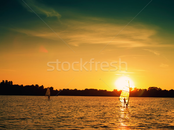 Surfing under the sail. Sport and laisure backgrounds Stock photo © tolokonov