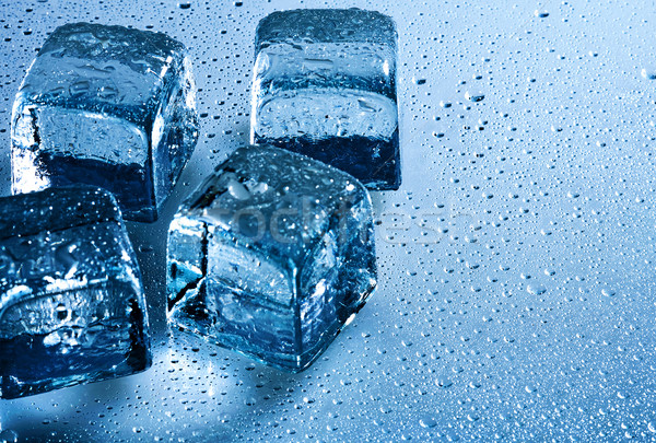 Ice cube and water drops on the wet background Stock photo © tolokonov