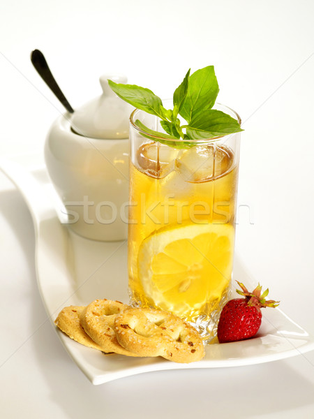 Cold black tea  with lemon, ice and water drops on the glass sur Stock photo © tolokonov