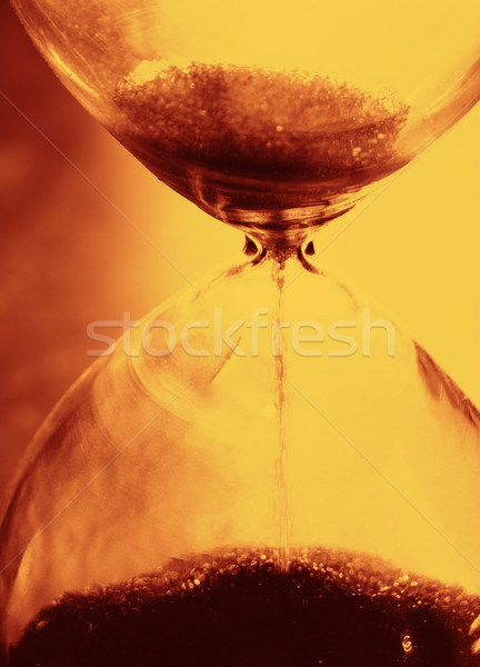 retro watches with falling grains of sand. time spending concept Stock photo © tolokonov