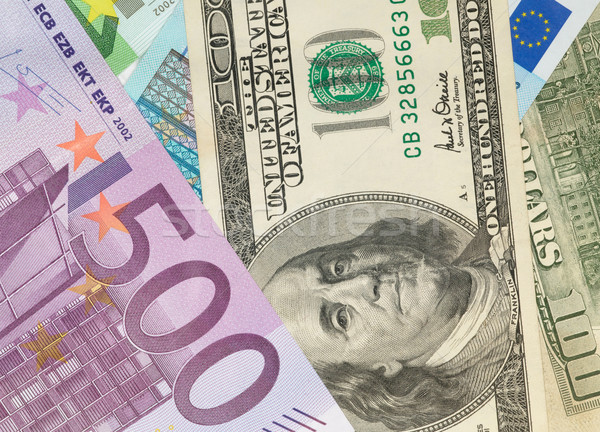Money background from dollars and euro banknotes Stock photo © tolokonov