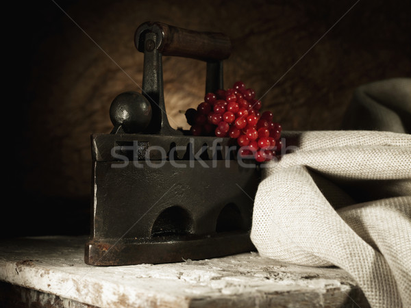 Abstract retro still life with vintage iron and hessian textile Stock photo © tolokonov