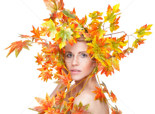Beautiful woman wrapped in autumn leafs Stock photo © tommyandone