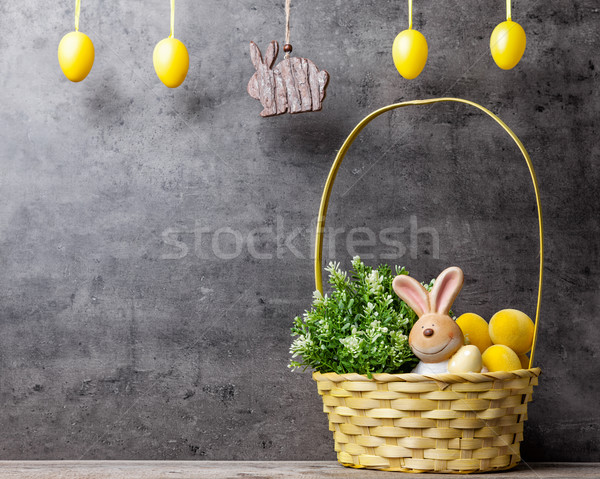 Easter holiday basket with a bunny, eggs and flowers Stock photo © tommyandone