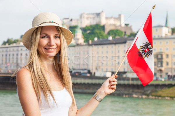 Female tourist on vacation in Salzburg Austria holding the Austrian flag Stock photo © tommyandone