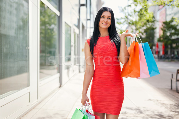 Beautiful woman outdoors with plenty of shopping bags Stock photo © tommyandone