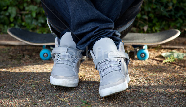Sitting on skateboard Stock photo © tommyandone