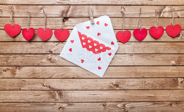 Love concept. Hearts and love letter hanging on a string Stock photo © tommyandone