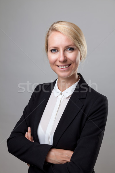 Young business woman in suit  Stock photo © tommyandone