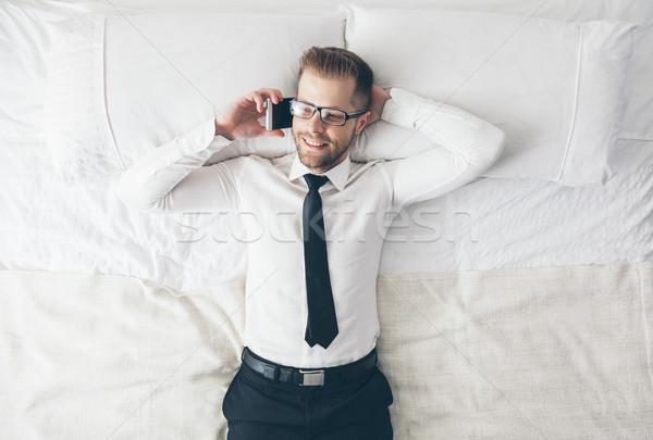 üst görmek yakışıklı işadamı gözlük yatak Stok fotoğraf © tommyandone