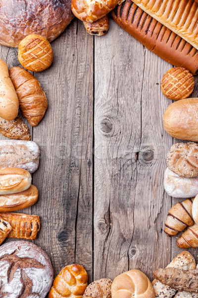 Stock photo: Delicious fresh bread on wooden background