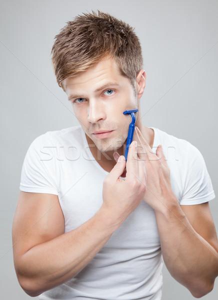 красивый мужчина портрет стороны лице человека красоту Сток-фото © tommyandone