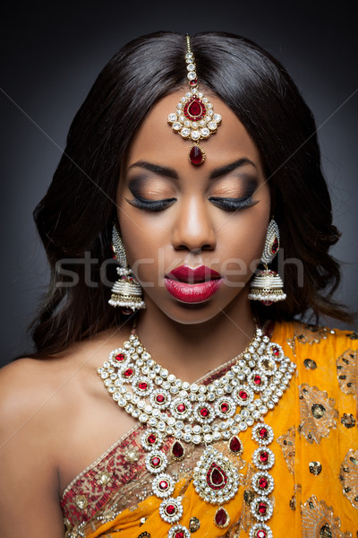 Young Indian woman in traditional clothing with bridal makeup and jewelry Stock photo © tommyandone