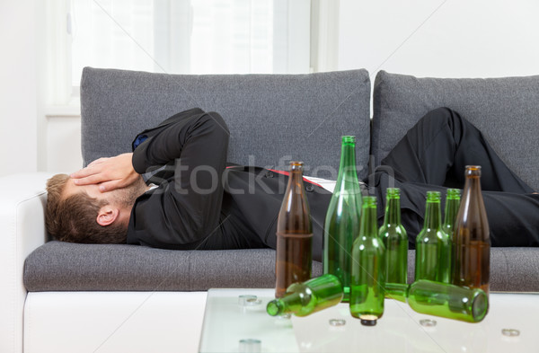 Depressed businessman drunk at home  Stock photo © tommyandone