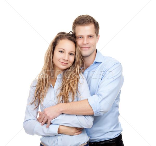 Genç mutlu çift gülen yalıtılmış beyaz Stok fotoğraf © tommyandone
