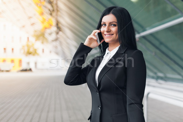 Successful business woman with mobile phone in an urban setting Stock photo © tommyandone