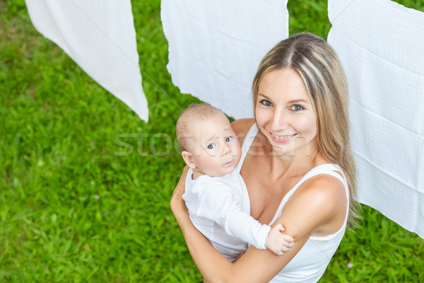 Beautiful mother and baby playing together outdoors Stock photo © tommyandone