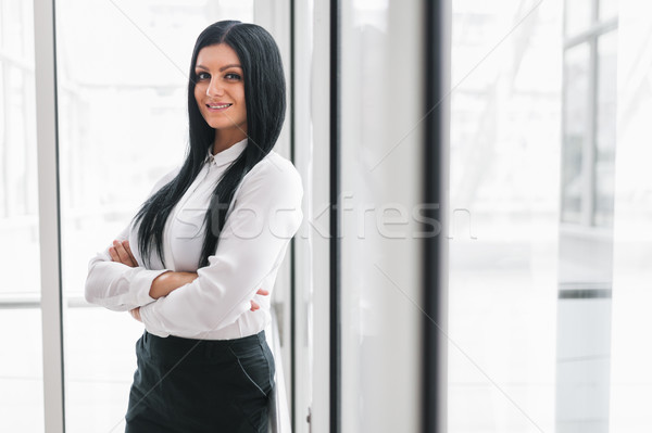 Successful confident business woman in an office setting Stock photo © tommyandone