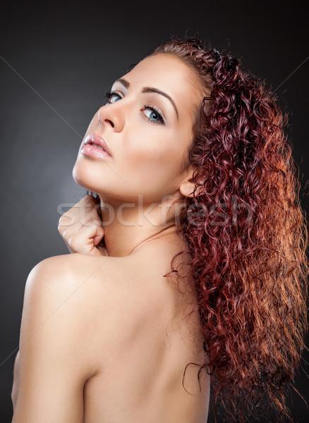 Güzel bir kadın kırmızı kıvırcık saçlı güzel genç kadın yüz Stok fotoğraf © tommyandone